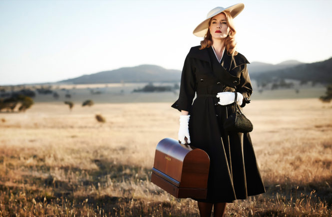 Kate Winslet In 50's Fashion Couture Holding a Vintage Singer Sewing Machine For The Dressmaker Movie